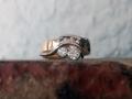 Ring 8 - Rödguldsring med vitguldsdetaljer och diamanter